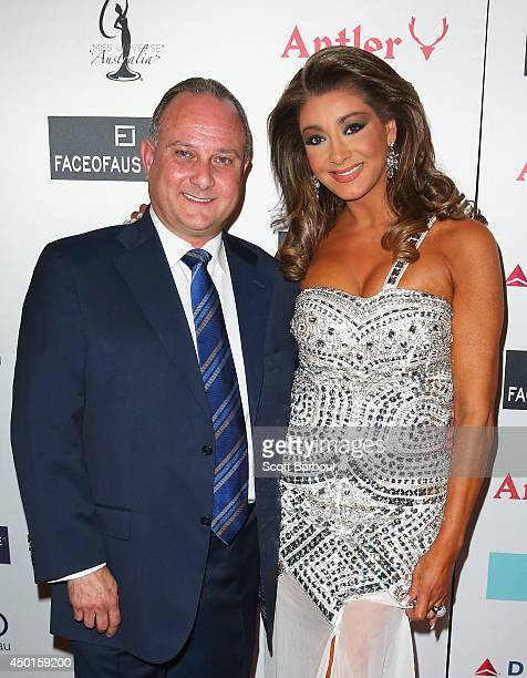 Gina Liano from The Real Housewives of Melbourne poses with her partner Dean Giannarelli as she arrives at Miss Universe Australia 2014 on June 6...