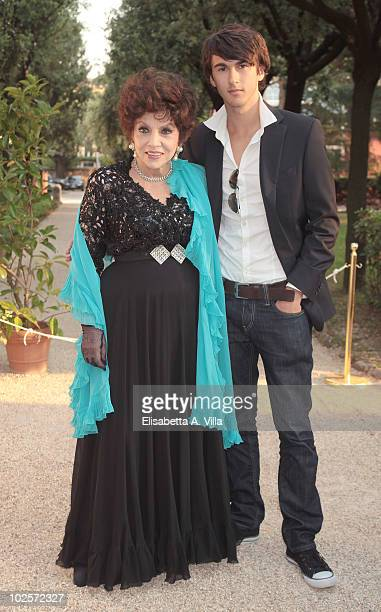Gina Lollobrigida and her grandson Dimitri Milko arrive at the 2010 Globo D'Oro Awards at Villa Massimo on July 1 2010 in Rome Italy