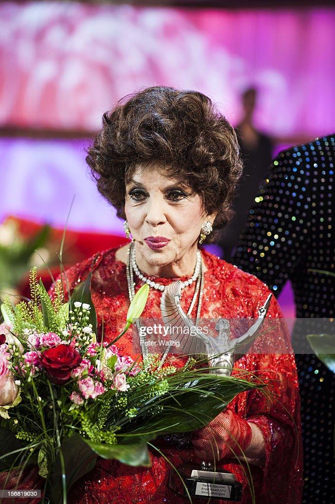 Gina Lollobrigida attends the photocall after the 'Desastroeoes Bis Pompoeoes - Der Modische Jahresrueckblick Des Herrn Gloeoeckler' TV Show on November 21, 2012 in Cologne, Germany.