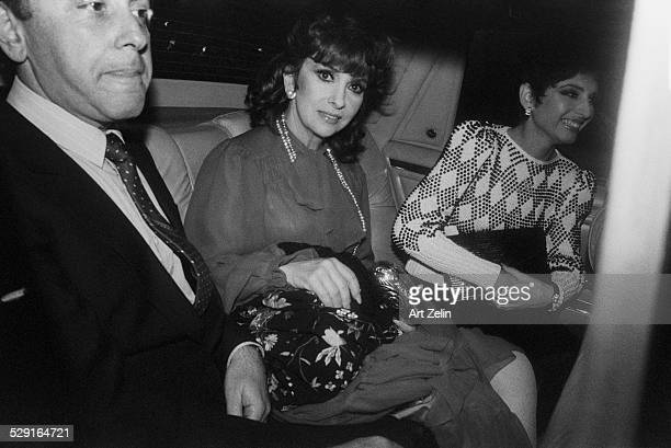 Gina Lollobrigida in a limousine with friends after a formal event circa 1970 New York