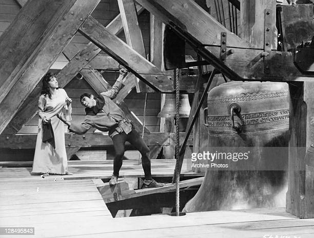 Gina Lollobrigida is led by Anthony Quinn in a scene from the film 'The Hunchback Of Notre Dame' 1956