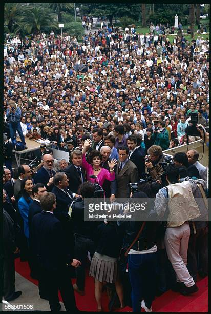 Gina Lollobrigida is swamped by the crowd on her visit to the Film Festival.