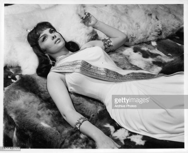 Gina Lollobrigida laying down in a scene from the film 'Solomon And Sheba' 1959