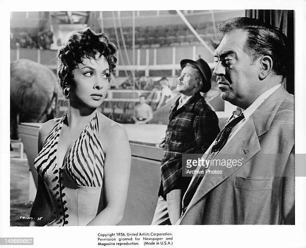 Gina Lollobrigida looking at Thomas Gomez in a scene from the film 'Trapeze' 1956