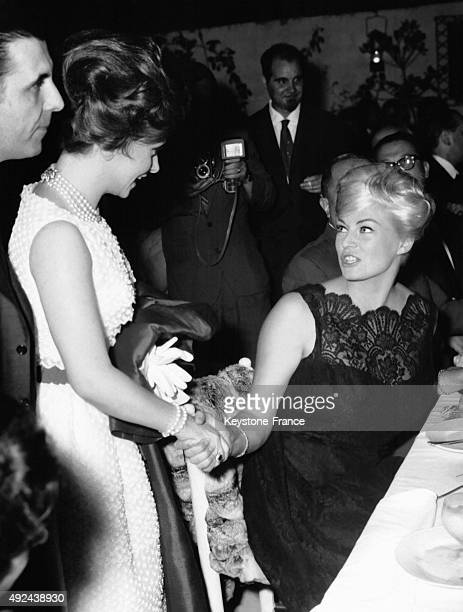 Gina Lollobrigida saying hello to Anita Ekberg at a gala diner on July 6 1961 in Rome Italy