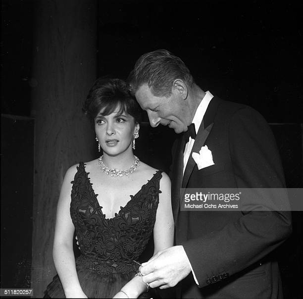 Gina Lollobrigida speaks with Danny Kaye during a party in Los AngelesCA