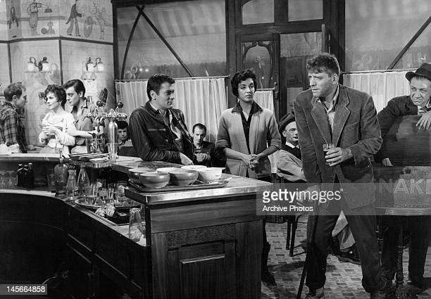 Gina Lollobrigida Tony Curtis Katy Jurado and Burt Lancaster at a French bistro in a scene from the film 'Trapeze' 1956
