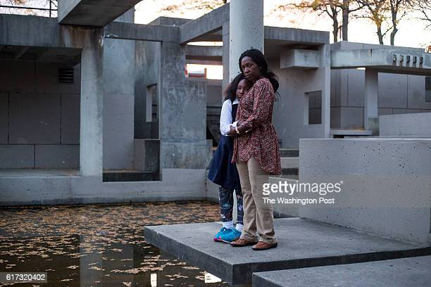 Gina Luster and her daughter Kennedy Luster stand at a now defunct water fountain in downtown Flint Mich on Tuesday October 11 2016 Luster a former...
