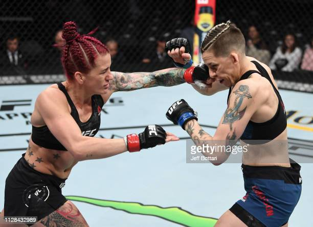 Gina Mazany and Macy Chiasson trade punches in their women's bantamweight bout during the UFC 235 event at TMobile Arena on March 2 2019 in Las Vegas...