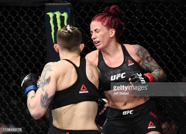 Gina Mazany is knocked out by Macy Chiasson in their women's bantamweight bout during the UFC 235 event at TMobile Arena on March 2 2019 in Las Vegas...