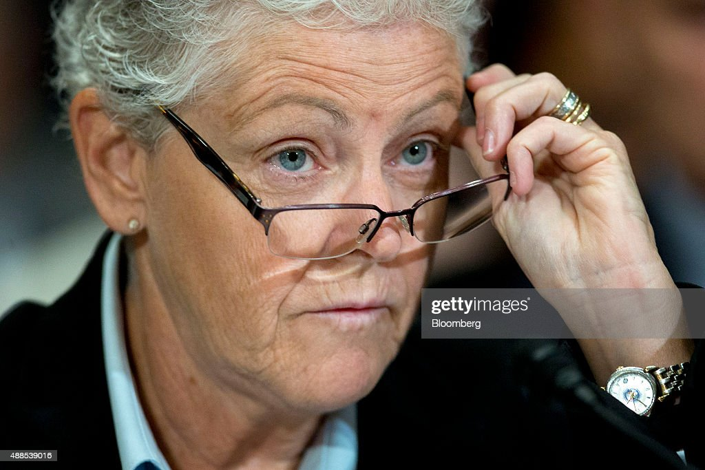Gina McCarthy, administrator of the Environmental Protection Agency (EPA), puts on her glasses during a Senate Environment and Public Works Committee hearing on the Gold King mine disaster in Washington, D.C., U.S., on Wednesday, Sept. 16, 2015. The August spill occurred when contractors for the EPA tried to open the blocked Gold King Mine to address leaks near Silverton, Colorado, accidentally releasing the toxic mining wastewater into the Animas River. Photographer: Andrew Harrer/Bloomberg via Getty Images