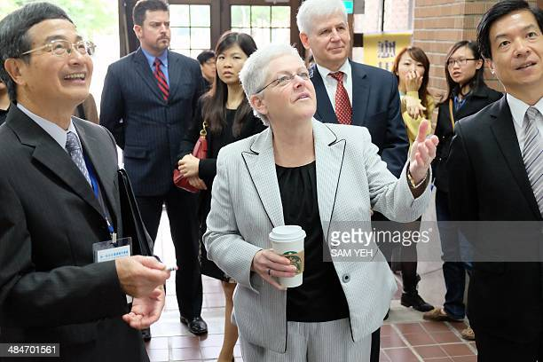 Gina McCarthy the administrator of the Environmental Protection Agency of the US gestures while visiting the National Taiwan University in Taipei on...