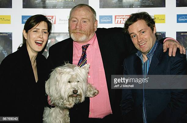 Gina McKee James Cosmo and Ardal O'Hanlon pose with Bobby the dog at the UK Gala Premiere of Greyfriars Bobby at Vue Omni Centre on February 7 2006...