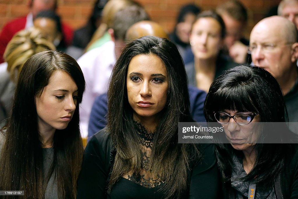 Gina Myers (C), a close personal friend to model Reeva Steenkamp is seen at the indictment hearing for South African athelete Oscar Pistorius at Pretoria Magistrates Court on August 19, 2013. Pistorius, 26, is accused of murdering his girlfriend Reeva Steenkamp which Pistorius denies claiming he mistook Steenkamp for an intruder. The indictment was served and the trial date of March 3, 2014 has now been set.