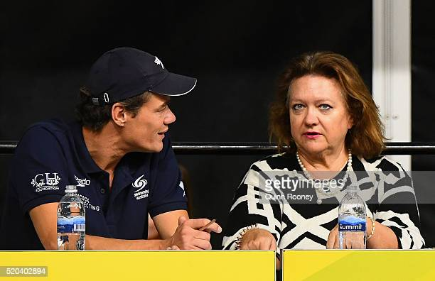 Gina Rinehart speaks to Jacco Verhaeren the Swimming Australia head coach during day five of the Australian Swimming Championships at the South...