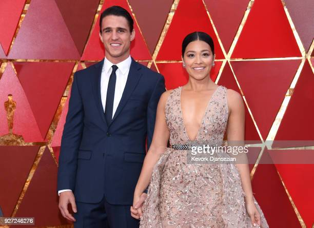 Gina Rodriguez and Joe Locicero attend the 90th Annual Academy Awards at Hollywood Highland Center on March 4 2018 in Hollywood California