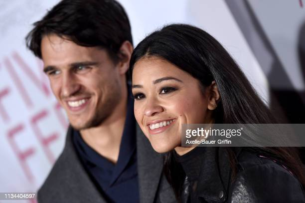 Gina Rodriguez and Joe Locicero attend the premiere of Lionsgate's 'Five Feet Apart' at Fox Bruin Theatre on March 07 2019 in Los Angeles California