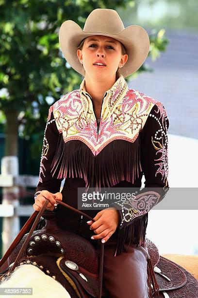 Gina Schumacher daughter of former German Formula One driver Michael Schumacher sits on her horse Sharp Dressed Shiner before presenting the elements...