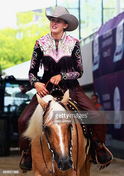 Gina Schumacher daughter of former German Formula One driver Michael Schumacher sits on her horse Sharp Dressed Shiner after presenting the elements...