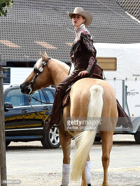 Gina Schumacher daughter of former German Formula One driver Michael Schumacher sits on her horse Sharp Dressed Shiner at a presentation of the...