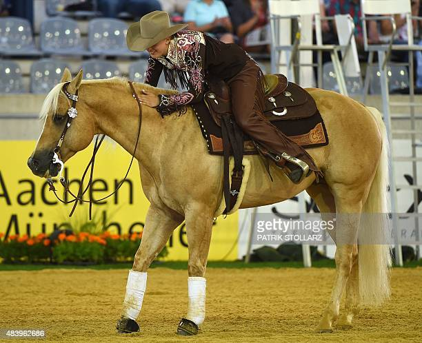 Gina Schumacher daughter of former German Formula One driver Michael Schumacher rides on her horse Sharp Dressed Shiner during a presentation of the...