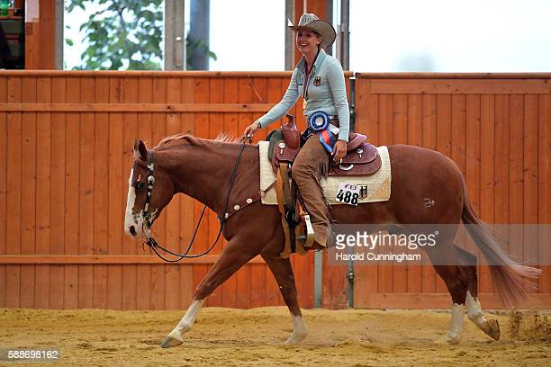Gina Schumacher of Germany celebrates her victory after the SVAG FEI European Championship Reining Young riders 2016 at the CS Ranch on August 12...