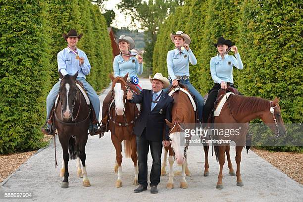 Gina Schumacher of Germany celebrates with her team their victory after the SVAG FEI European Championship Reining Young riders 2016 at the CS Ranch...