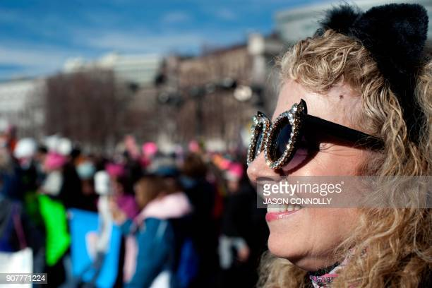 Gina Simpson of Denver Colorado listens to speakers during the Denver's Women's March in Denver Colorado on January 20 one year after thousands of...