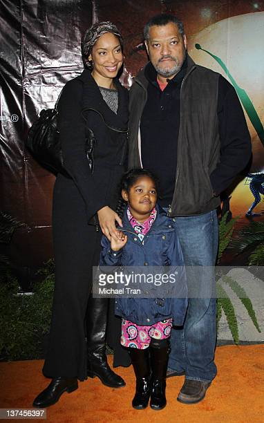 Gina Torres with Laurence Fishburne and their daughter arrive at the Cirque du Soleil OVO celebrity opening night gala held at Santa Monica Pier on...