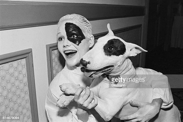 Gina Wilde and her English bull terrier Sadi sport matching patches as they compete in the Lucky Dog LookAlike Contest in Houston Texas Finalist from...