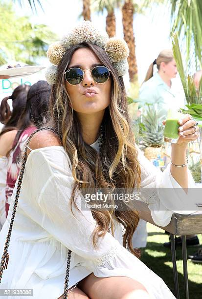 Gina Ybarra sips a Dole smoothie during the Sunshine Squad Brunch by Dole Packaged Foods at Ritz Carlton Rancho Mirage on April 17 2016 in Rancho...