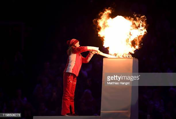 Gina Zehnder of Switzerland prepare to light the Olympic Flame during the Opening Ceremony of the Lausanne 2020 Winter Youth Olympic Games at...
