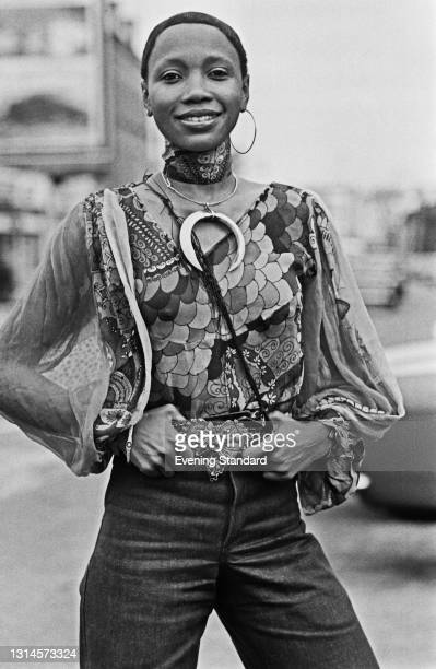 Gina-Jameila, a model wearing a patterned blouse and jeans, UK, 29th September 1973.