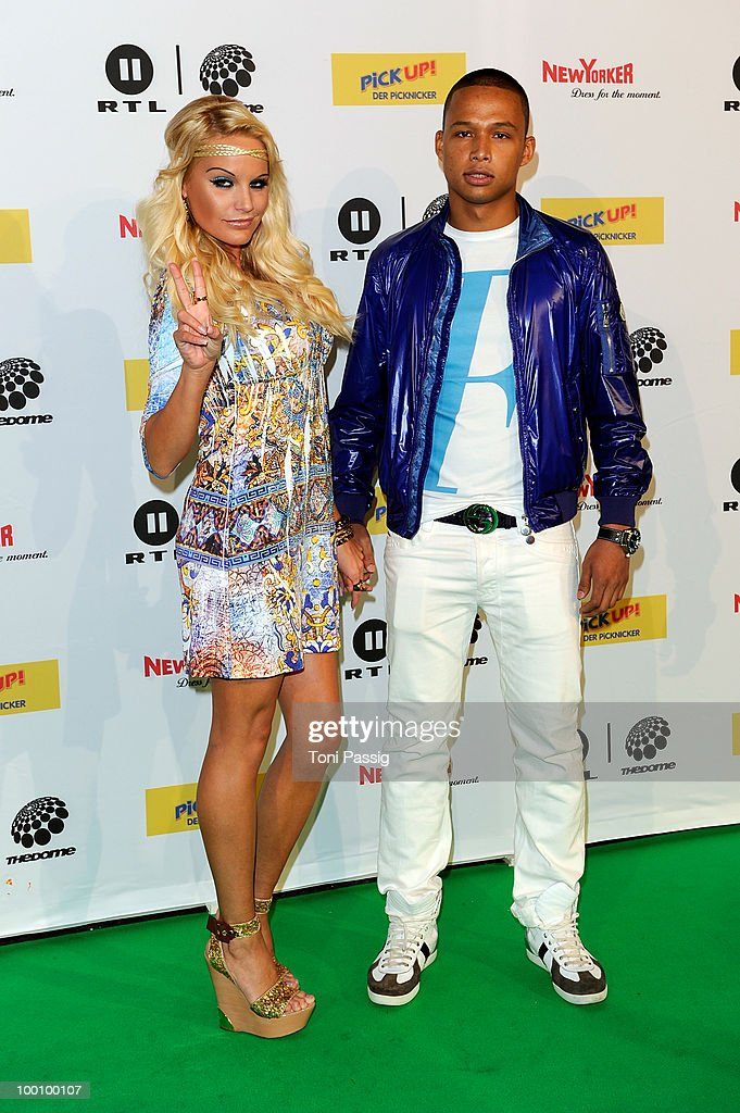Gina-Lisa Lohfink and boyfriend Romulo Kuranyi arrive at 'The Dome 54' at Schleyerhalle on May 20, 2010 in Stuttgart, Germany.