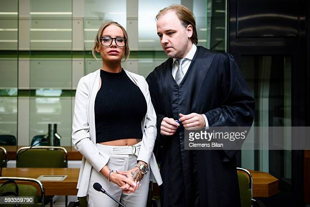 Gina-Lisa Lohfink and lawyer Burkhard Benecken talk at the biginning of a court trial on August 22, 2016 in Berlin, Germany. The 29-year-old model...