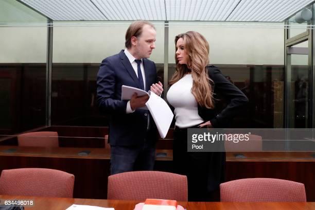 Gina-Lisa Lohfink speaks with her lawyer Burkhard Benecken during her appeal hearing at the Tiergarten regional court on February 10, 2017 in Berlin,...