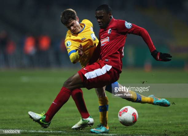 Ginaluca Korte of Braunschweig and Cedrick Makiadi of Freiburg compete for the ball during the second round DFB Cup match between Eintracht...