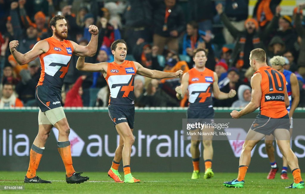 Ginats players celebrate winning the round six AFL match between the Greater Western Sydney Giants and the Western Bulldogs at UNSW Canberra Oval on April 28, 2017 in Canberra, Australia.