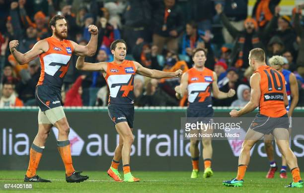 Ginats players celebrate winning the round six AFL match between the Greater Western Sydney Giants and the Western Bulldogs at UNSW Canberra Oval on...