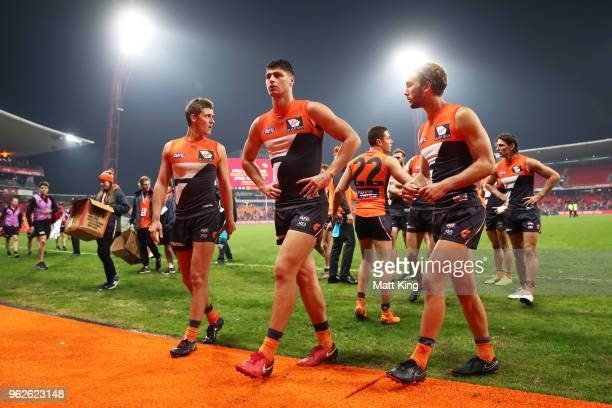 Ginats players look dejected as they leave the ground during the round 10 AFL match between the Greater Western Sydney Giants and the Essendon...