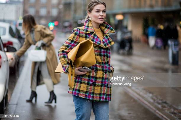 Gine Margethe wearing yellow checked coat turtleneck yellow oversized bag outside Anne Vest during the Copenhagen Fashion Week Autumn/Winter 18 on...