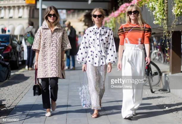 Gine Margrethe Emili Sindlev wearing a white dotted blouse Jeanette Madsen wearing Miu Miu sweater white overall outside Whyred on August 30 2017 in...