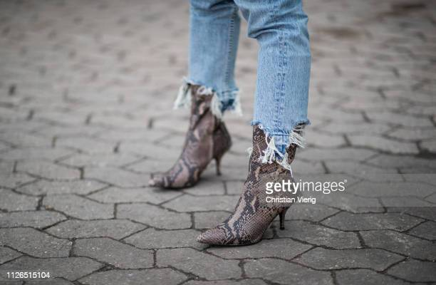 Gine Margrethe is seen wearing ripped denim jeans, boots with snake print outside Munthe during the Copenhagen Fashion Week Autumn/Winter 2019 - Day...