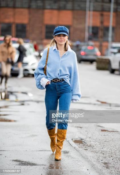 Gine Margrethe seen wearing cardigan, denim jeans, baker boy cap, boots with snake print outside Rodebjer during Copenhagen Fashion Week...