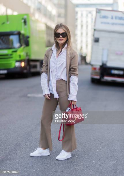 Gine Margrethe wearing light brown suit red Saint Laurent bag striped button shirt white sneakers outside byTiMo on August 22 2017 in Oslo Norway