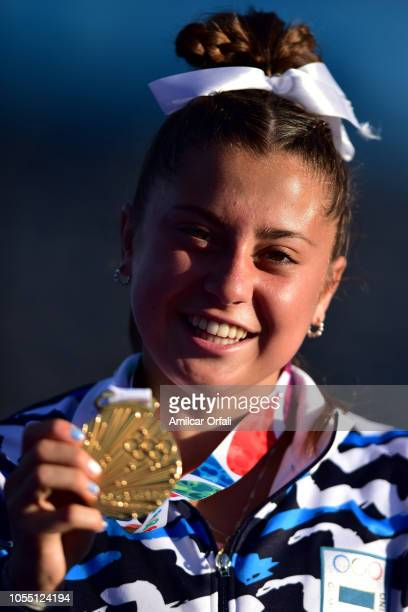 Ginella Palet of Argentina celebrates with her Gold Medal after the Women's Gold Medal Match against India during day 8 of the Buenos Aires Youth...