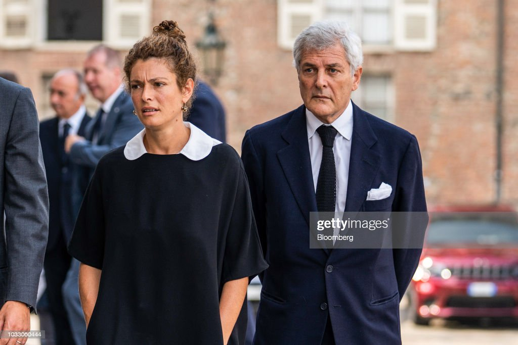 Ginevra Elkann, a filmmaker, left, and Alain Elkann, a French-Italian writer, arrive for a memorial service for former Fiat Chrysler Automobiles NV chief executive officer Sergio Marchionne at the cathedral in Turin, Italy, on Friday, Sept. 14, 2018. Marchionne, the architect of the automaker's dramatic turnaround died, aged 66, on Wednesday, July 25, 2018. Photographer: Federico Bernini/Bloomberg via Getty Images