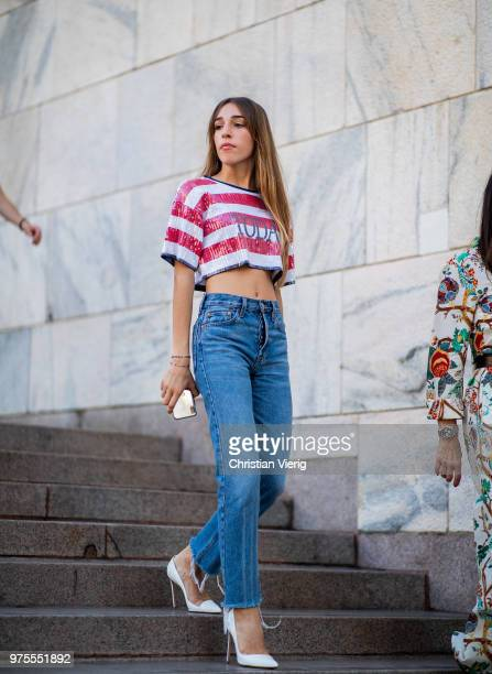 Ginevra Lambruschi wearing croped striped top denim jeans is seen outside Alberta Ferretti during Milan Men's Fashion Week Spring/Summer 2019 on June...