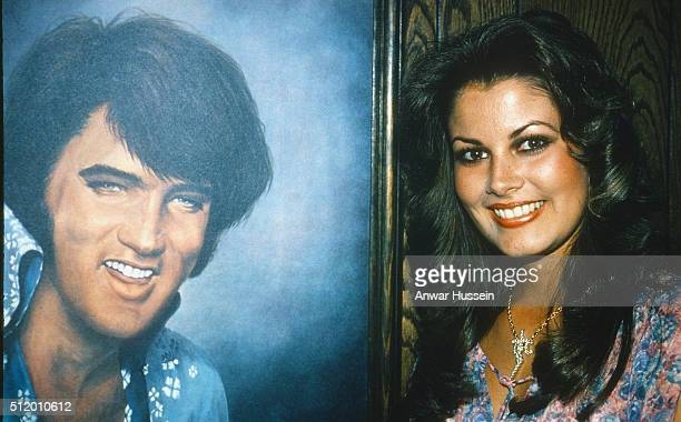 Ginger Alden fiancee of Elvis Presley and the last person to see him alive stands beside a portrait of Elvis on April 01 1978 in USA