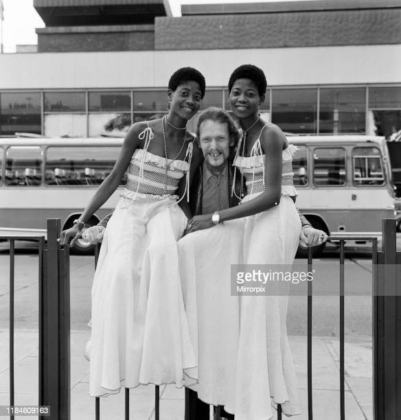Ginger Baker, Drummer and founder of the rock band Cream, pictured with the Lijadu Sisters, Taiwo and Kehinde Lijadu, identical twin sisters aged 21...